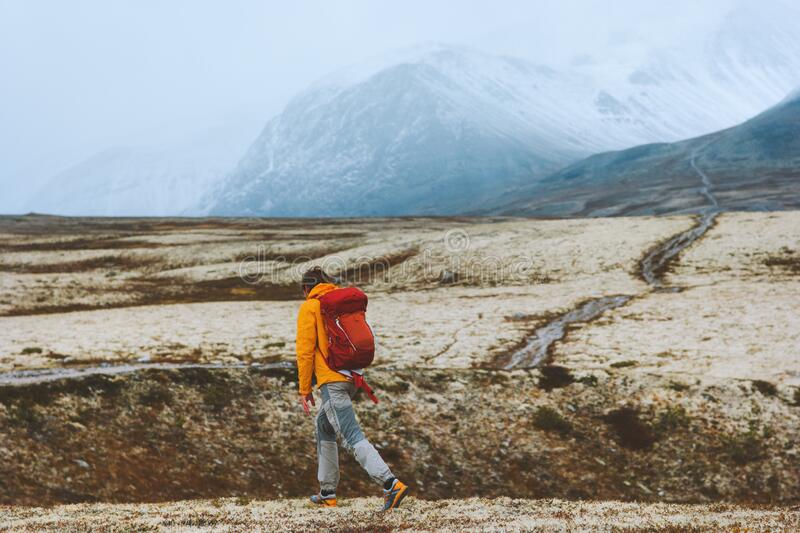 Man hiker in mountains backpacking travel vacations outdoor adventure royalty free stock photos
