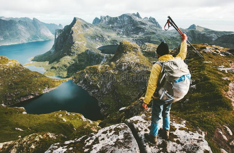 Man hiker standing on cliff mountain top stock photography