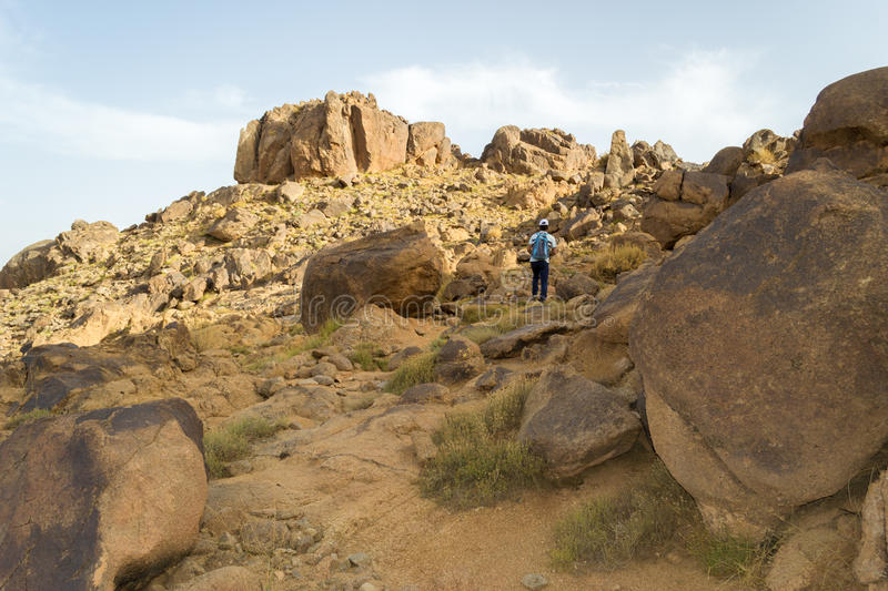 Man hiking alone in the desert royalty free stock photography