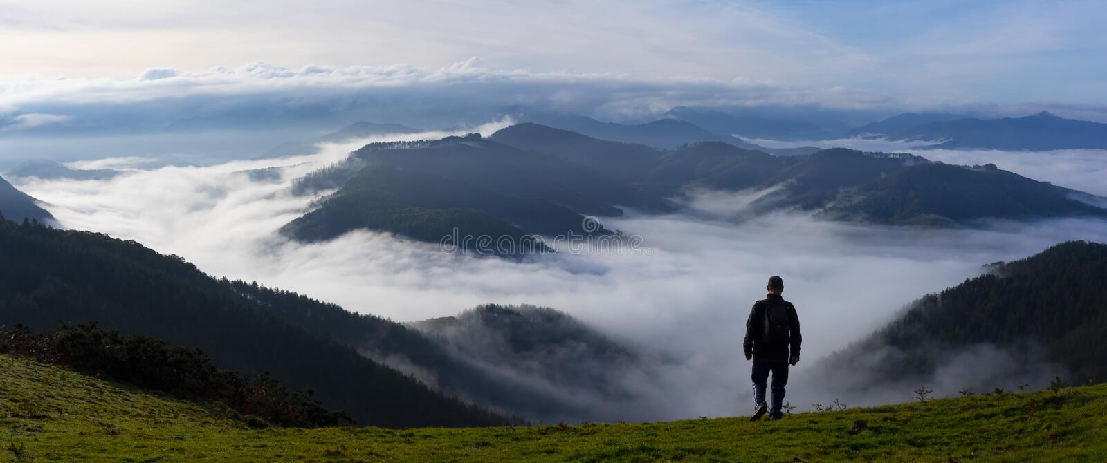 Man hiking on background of misty autumn mountains royalty free stock photos