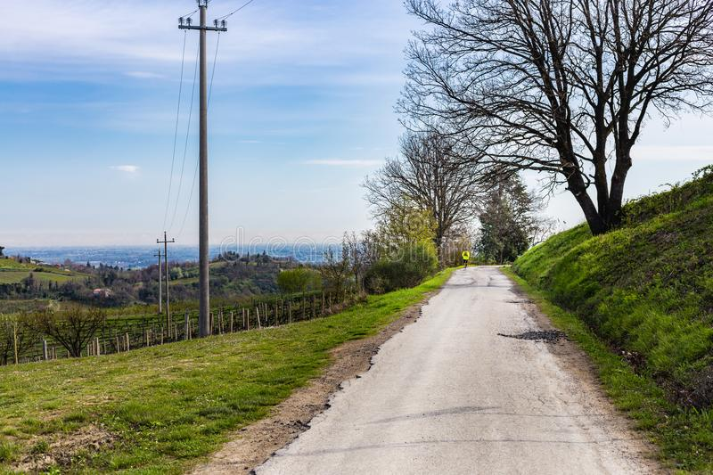 Man hiking on country road. In Italy stock images
