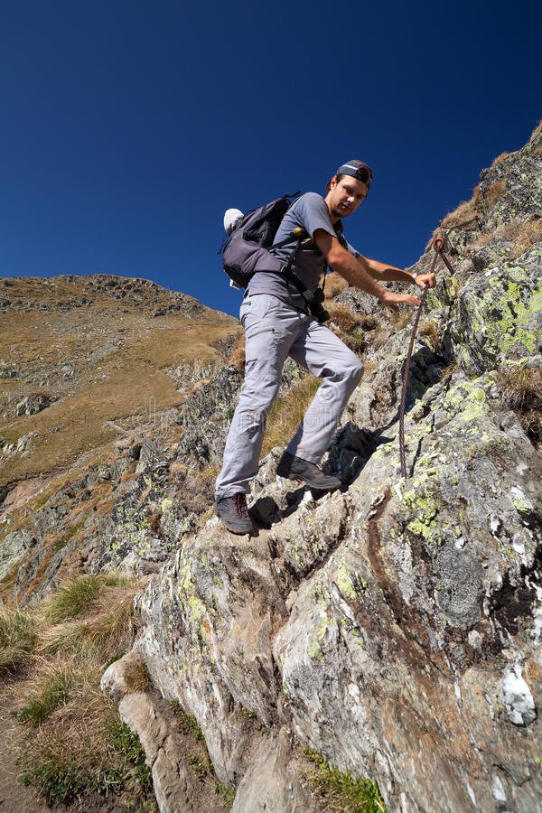 Download Man Hiking On Difficult Mountain Trail Stock Photo - Image: 26490280
