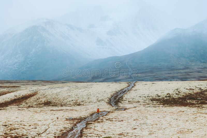 Man hiking in foggy mountains adventure travel vacations outdoor royalty free stock photography
