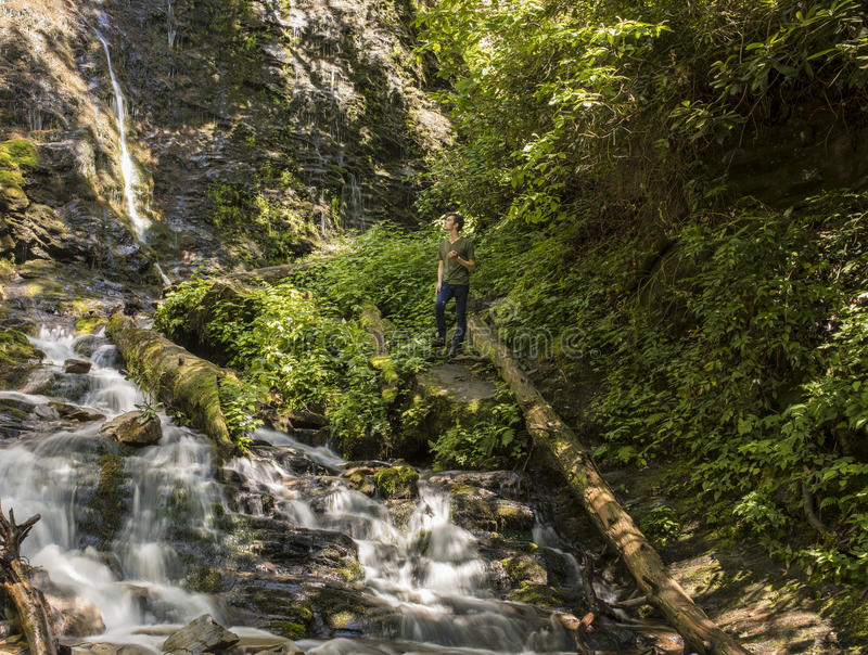 Man hiking in the Great Smoky Mountains. Man hiking at Mingo Falls in the Great Smoky Mountains royalty free stock image