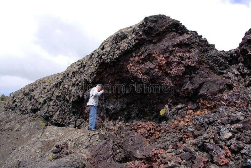 Download Man Hiking In Lava Splatter Zone Royalty Free Stock Photo - Image: 32327435