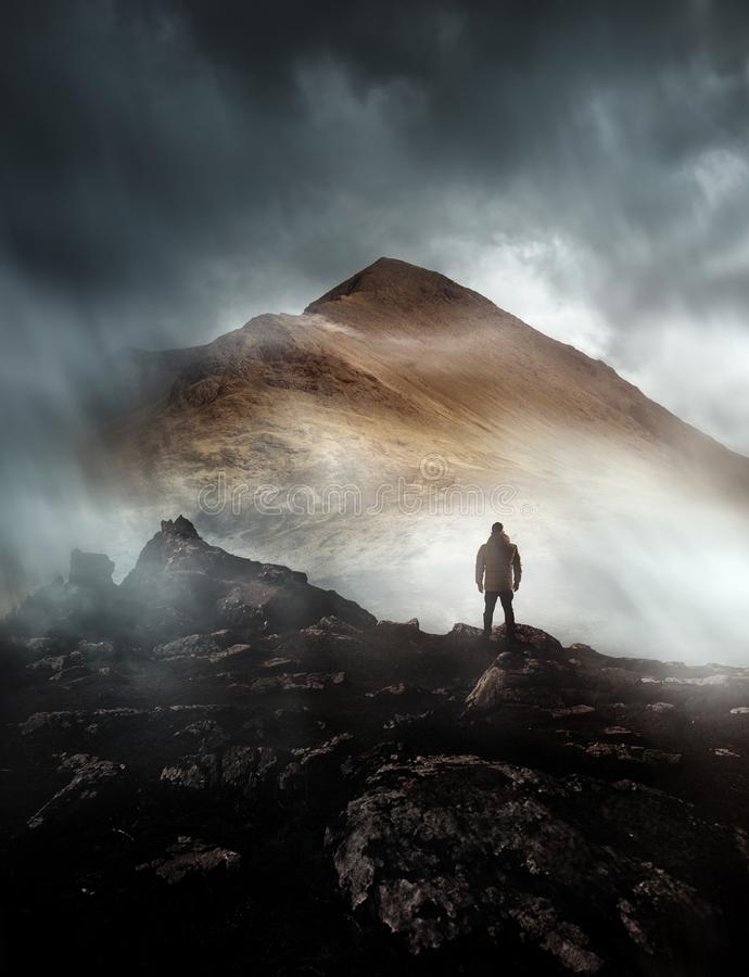 Man Hiking On A Misty Mountain royalty free stock image