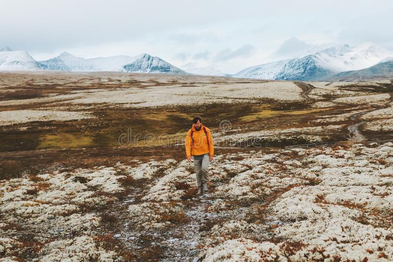 Man hiking in mountains travel vacations outdoor royalty free stock photography