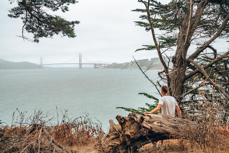 Man hiking in San Francisco, exploring golden gate park and twin peaks hills. royalty free stock photo