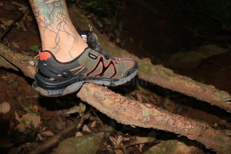 The man with hiking shoes in the night stock photos
