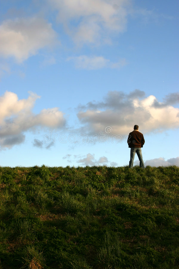 Man on hill stock images