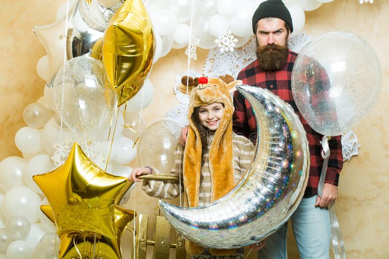 Man hipster and child at xmas. Father and daughter smile with balloons, christmas. Family holiday party. Fathers day stock photo