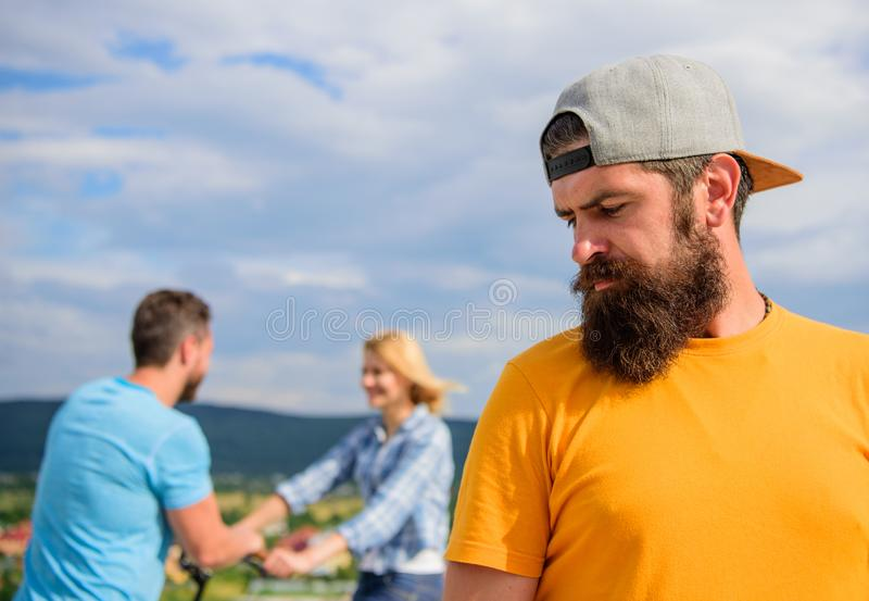 Man hipster feels lonely couple dating behind him. Unlucky romantic life. Guy adult still lonely while friends happy stock images