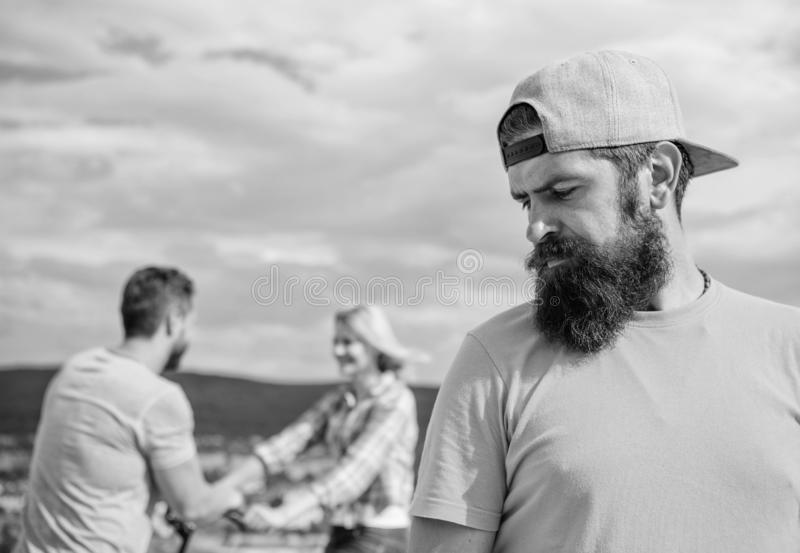 Man hipster feels lonely couple dating behind him. Unlucky romantic life. Guy adult still lonely while friends happy stock image