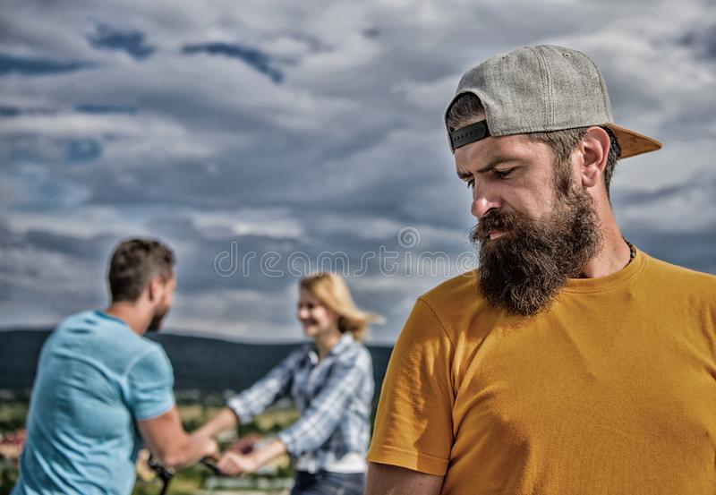 Man hipster feels lonely couple dating behind him. Unlucky romantic life. Guy adult still lonely while friends happy royalty free stock photography