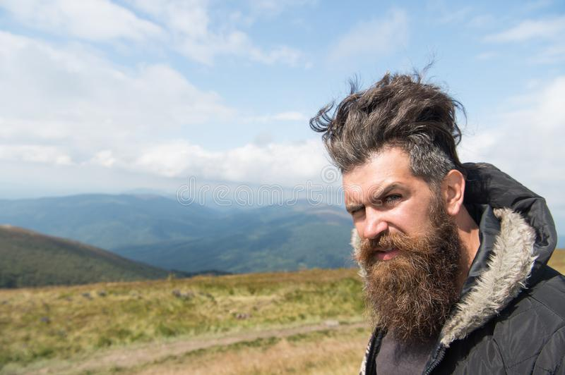 Man hipster with long beard hair on mountain landscape royalty free stock photos