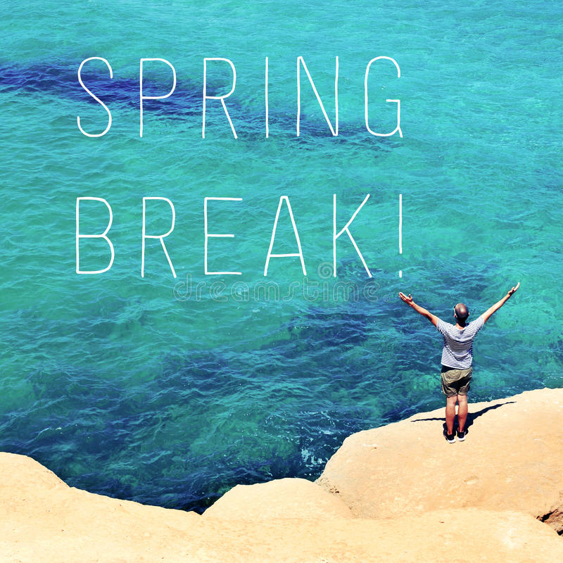 Man with his arms in the air and text spring break royalty free stock image