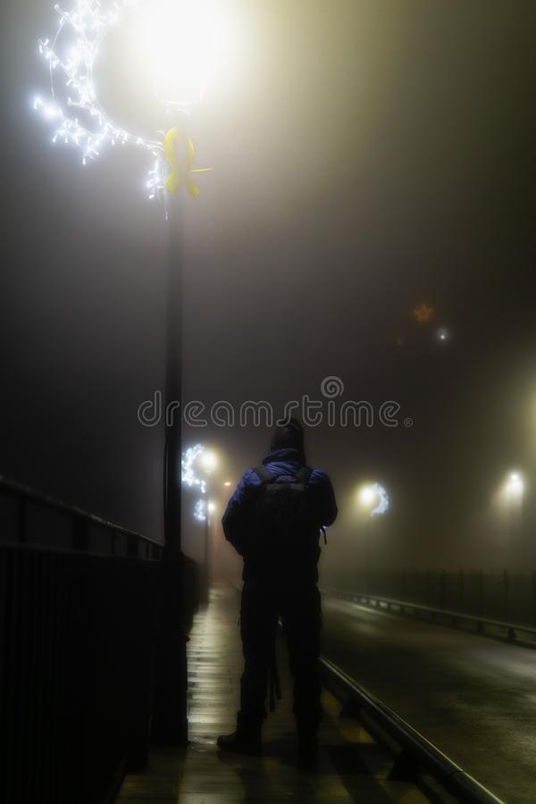 Mysterious man among fog royalty free stock photography