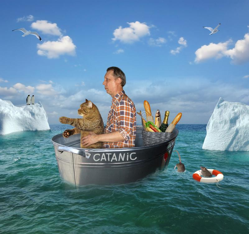 Man and his cat drift in a washtub stock photography