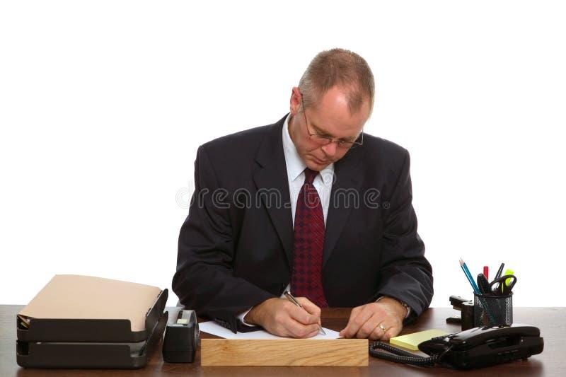 Man at his desk royalty free stock photos