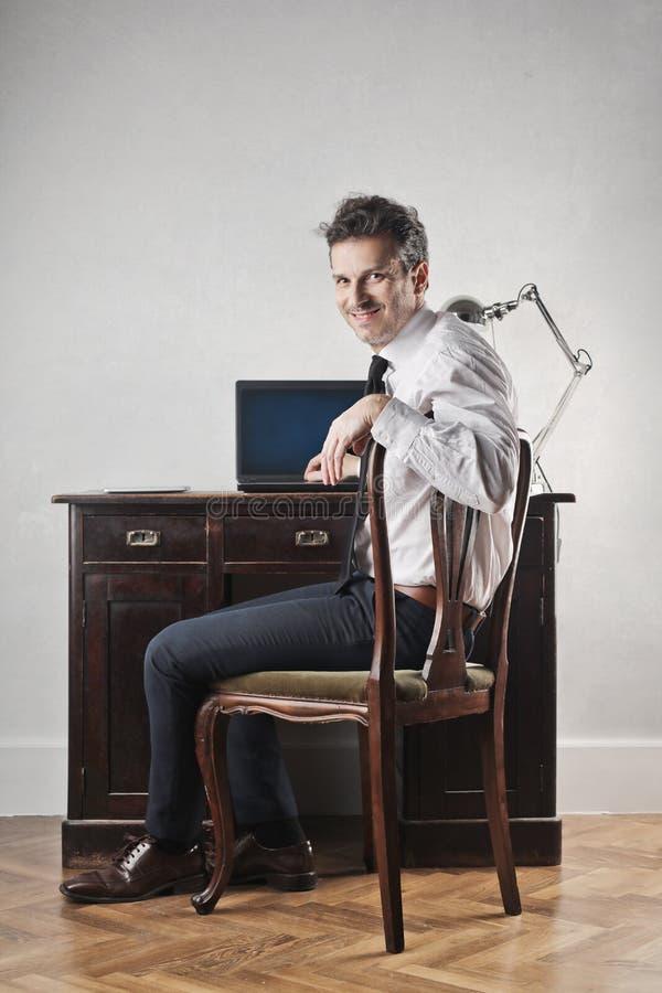 Man at his desk stock photos