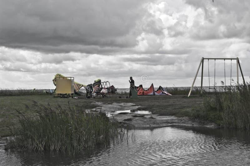 Man and his dragon. Kiteboarding, beach at Baltic sea. Athlete waiting for a good wind. Location: Estonia, Pärnu stock photos