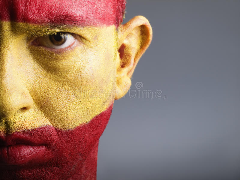 Man with his face painted with the flag of Spain royalty free stock image
