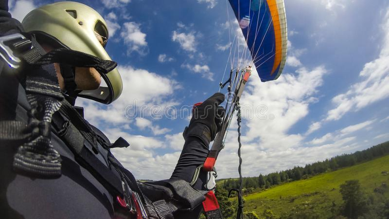 Man with his flying paraglider royalty free stock photo