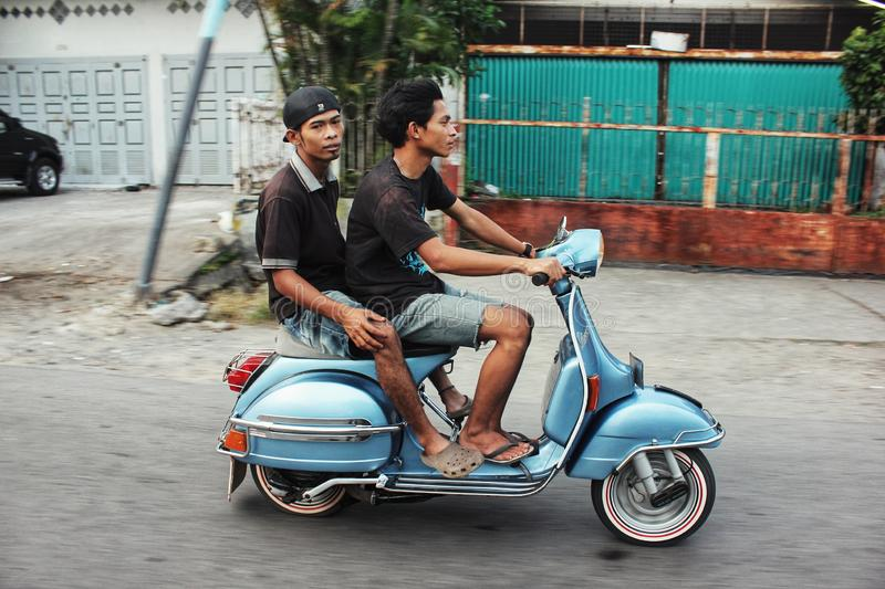 A man and his friend ride a motorcycle. stock photo