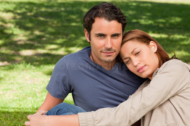 Download Man With His Friend Who Is Resting Her Head On His Shoulder Stock Photo - Image: 25332150