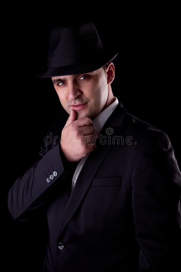 Man with his hand to his lips in a seductive pose stock photo