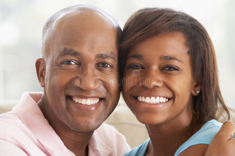 Man With His Teenage Daughter. Portrait Of Man With His Teenage Daughter stock photo