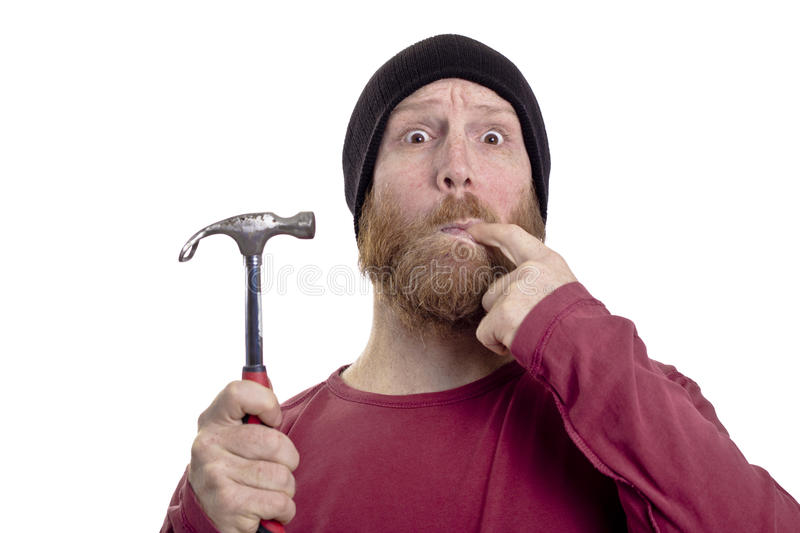 Man hit finger with hammer. Isolated on white background, carpenter royalty free stock images