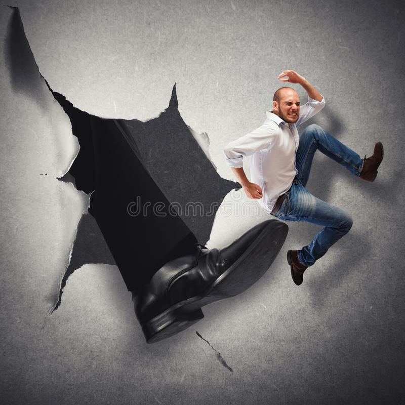 Dismissal employee. Man hit by kick of big foot stock photography