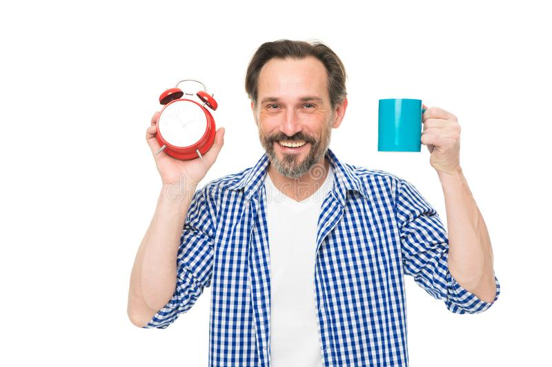 Man hold alarm clock and mug coffee. Morning habits. Take control of time. Check time. Tips for saving time. Self royalty free stock images