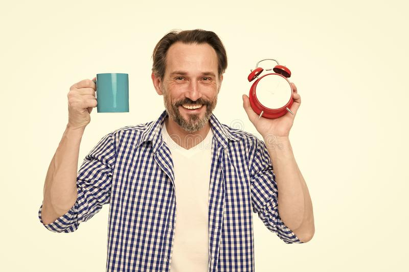 Man hold alarm clock and mug coffee. Morning habits. Take control of time. Check time. Tips for saving time. Self. Discipline. Control and discipline. Drink royalty free stock image