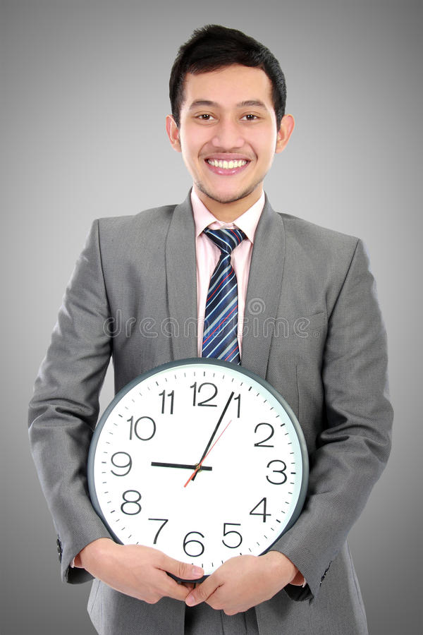 Download Man Hold Clock Royalty Free Stock Photo - Image: 27543975