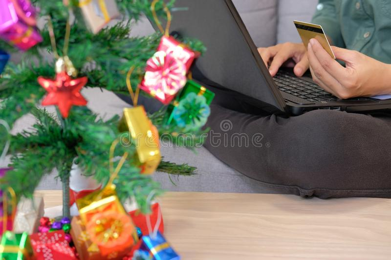 man hold credit card for online shopping. male buyer buying christmas gift on internet. new year holiday merry xmas celebration stock image