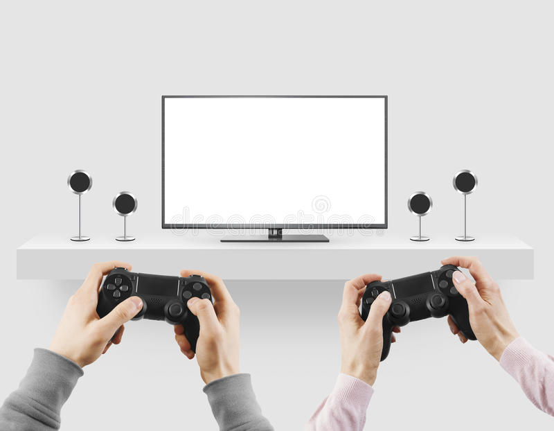 Man hold gamepad in hands in front of blank tv screen mock up pl stock photos