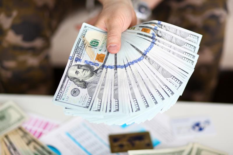 Man hold in hand big fat pack of US money royalty free stock photo