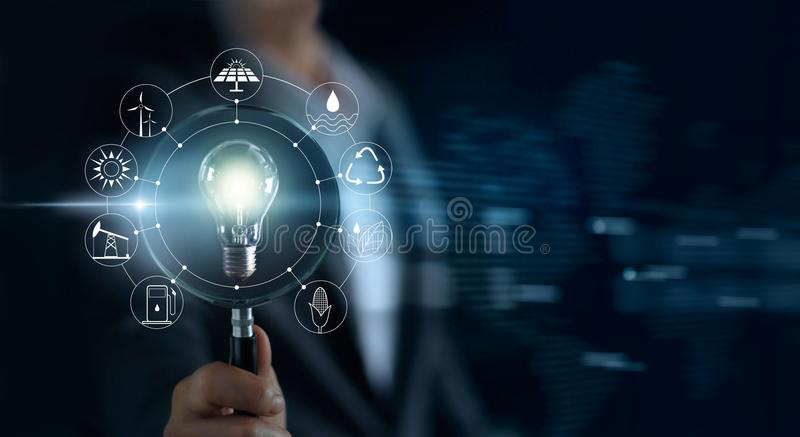 Man hold magnifying glass and light bulb, serch for network stock photo