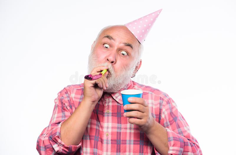 Man hold party cone hat and whistle. anniversary holiday celebration. happy birthday. corporate party. happy man with. Beard. retirement party. mature bearded royalty free stock photo