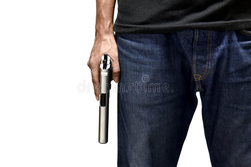 A man hold and resting firearm beside body. Front view stock photo