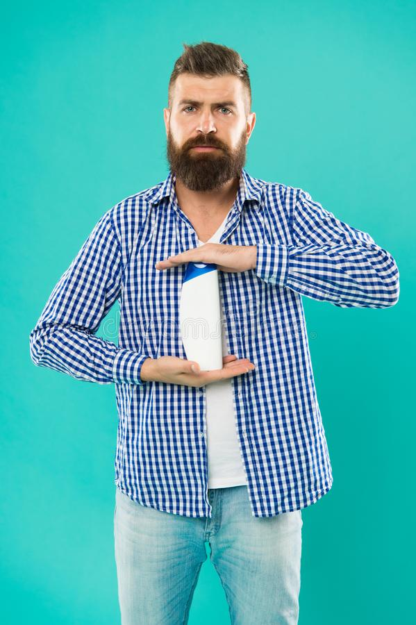 Man hold shampoo bottle. Shampoo and conditioner you choose can make all difference in hair starting right at roots royalty free stock photography