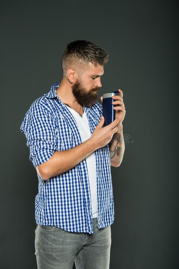 Man hold shampoo bottle. Hair care and skincare. Handsome bearded guy recommend shower gel liquid soap product. Personal. Hygiene. Shower gel. Bodycare cosmetic royalty free stock photos