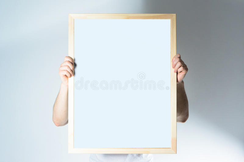 Man hold Wood frame, mock up, on the white background. Man hold Wood frame, mock up stock photo