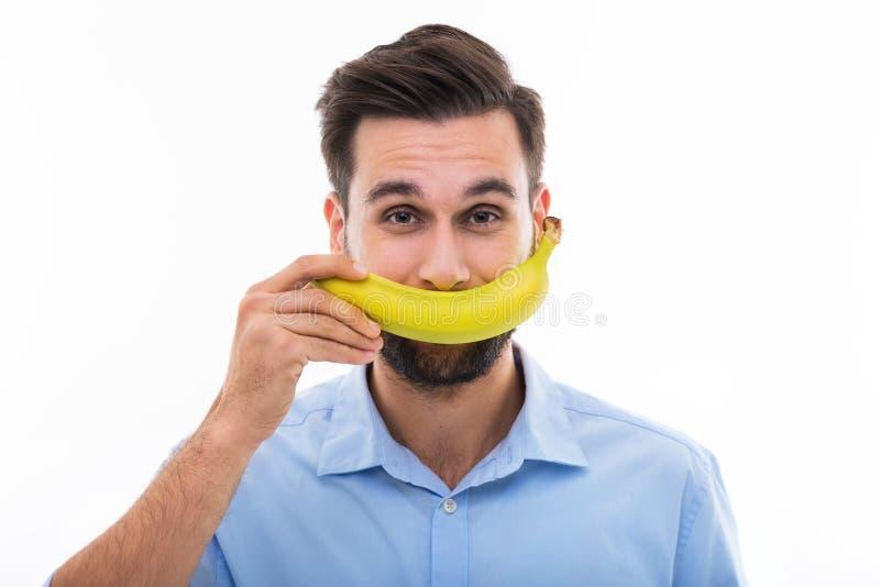Man holding banana over face royalty free stock photos