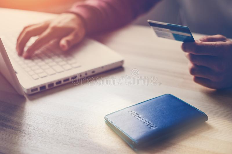 Man holding bank card. Laptop and passport on the table. Web shopping royalty free stock images