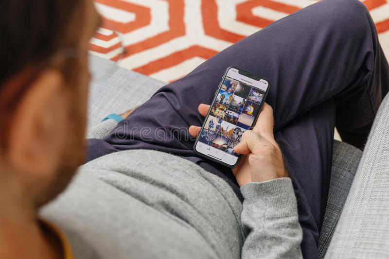 Man holding Barack Obama instagram photos on the new Apple iPho stock images