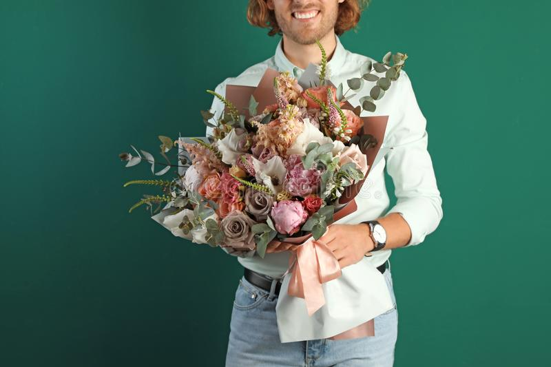 Man holding beautiful flower bouquet on green background stock photos