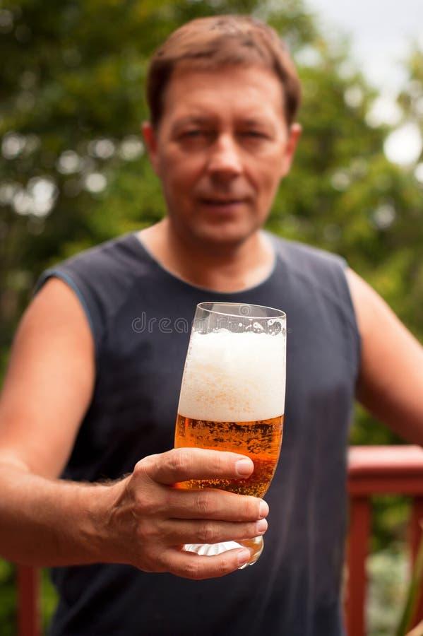 Man Holding Beer stock photos